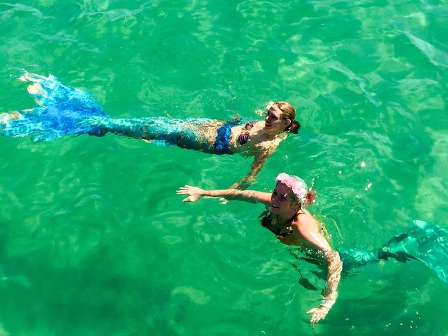 Interactive Mermaids Coogee, WA April 3,2016 Entertainment Festival Event Indian Ocean Beach Western Australia Coogee Beach Festival Performers Costumes Mermaid Interactive  Colorful Tails Turquoise Water Sea Swimming Clear Water Mermaid Swimming Interactive Art Performance Art Water Reflections Water People
