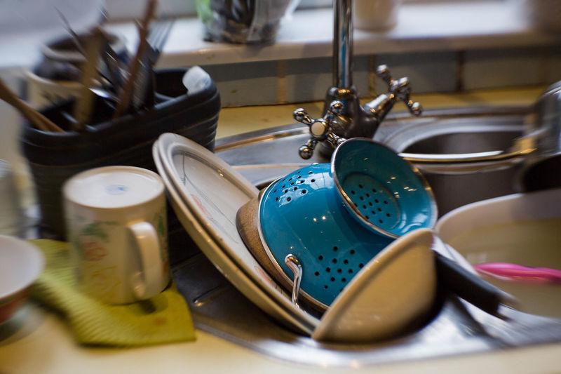 Close up of kitchen utensils in sink