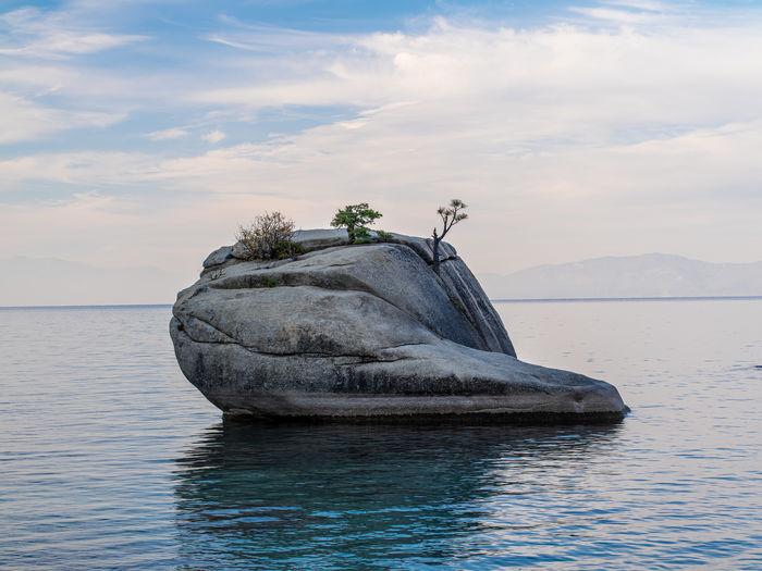 View of rock in sea against sky