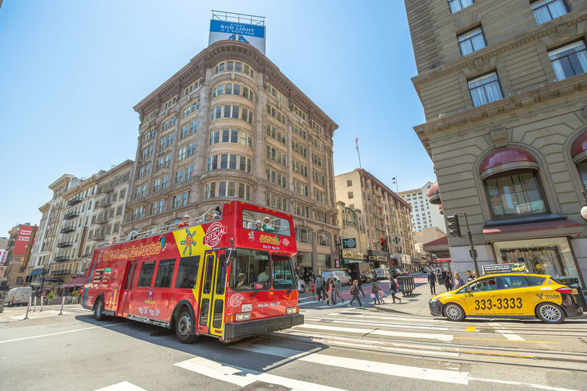 San Francisco, CA, United States - August 17, 2016: crowds of tourists in the popular Union Square, the central square of San Francisco on Market Street, known as the place shopping and luxury hotels. San Francisco, California, United States - August 17, 2016: the Big Bus, Hop On Hop Off, Sightseeing Tour, the popular double-decker bus carrying tourists, standing in Union Square, during a day tour. Cable Car California Market SF San Francisco Square Union Union Square SF United States Architecture Building Exterior Built Structure Car City Clear Sky Day Land Vehicle Market Street San Francisco Market Street No People Outdoors Road Sky Street Transportation Union Square  Unionsquare
