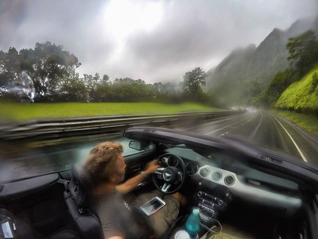 Driving in the rain Car Interior Convertible Cruisin Dashboard Driving Ford Ford Mustang Having Fun Hawaii Journey Mustang Oahu On The Road One Person Open Top Outdoors Road Roadtrip Self Portrait Sports Car Steering Wheel The Drive Travel USA Finding New Frontiers Second Acts