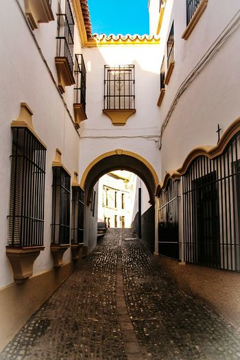 Architecture Arch Architectural Column Travel Destinations Built Structure No People Day Outdoors Check This Out EyeEm Gallery Málaga,España Building Exterior Tunel Tunelvision Andalucia Spain Ronda, Malaga Ronda Street Rejas Empedrado Tipical House Travel Vertical The City Light