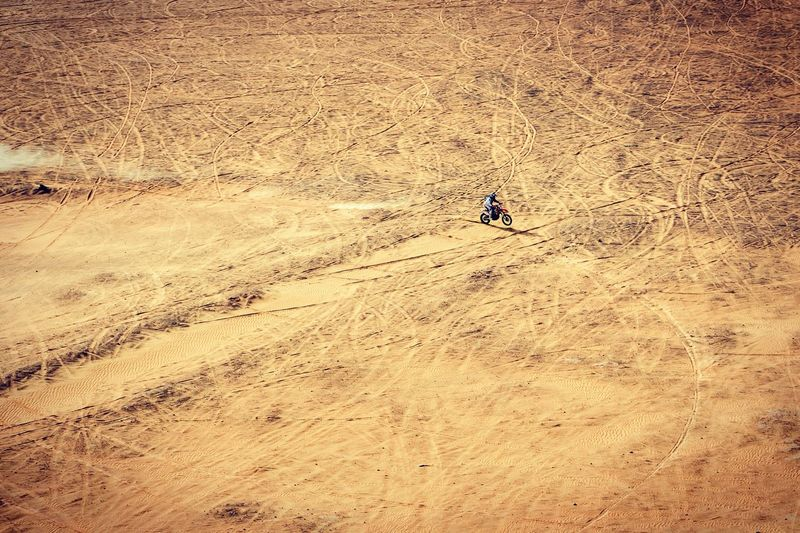 High angle view of person riding dirt bike on field