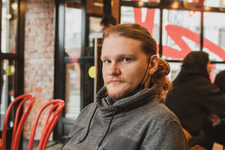 Portrait of man sitting at cafe