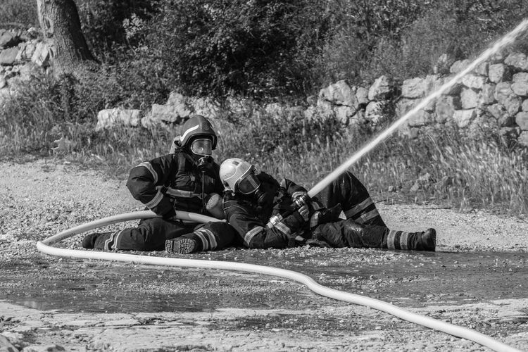 Rescue workers holding pipe