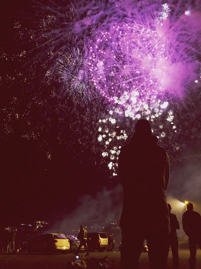 Night Illuminated Real People Silhouette Rear View Nature Sky Togetherness Firework Celebration Men City Two People Leisure Activity Adult People Lifestyles Outdoors Motor Vehicle Silhouette Nature Car Celebration Motion Adult City Smoke - Physical Structure Transportation Exploding Event