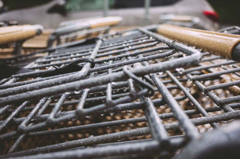 Close-up of wet metal grates