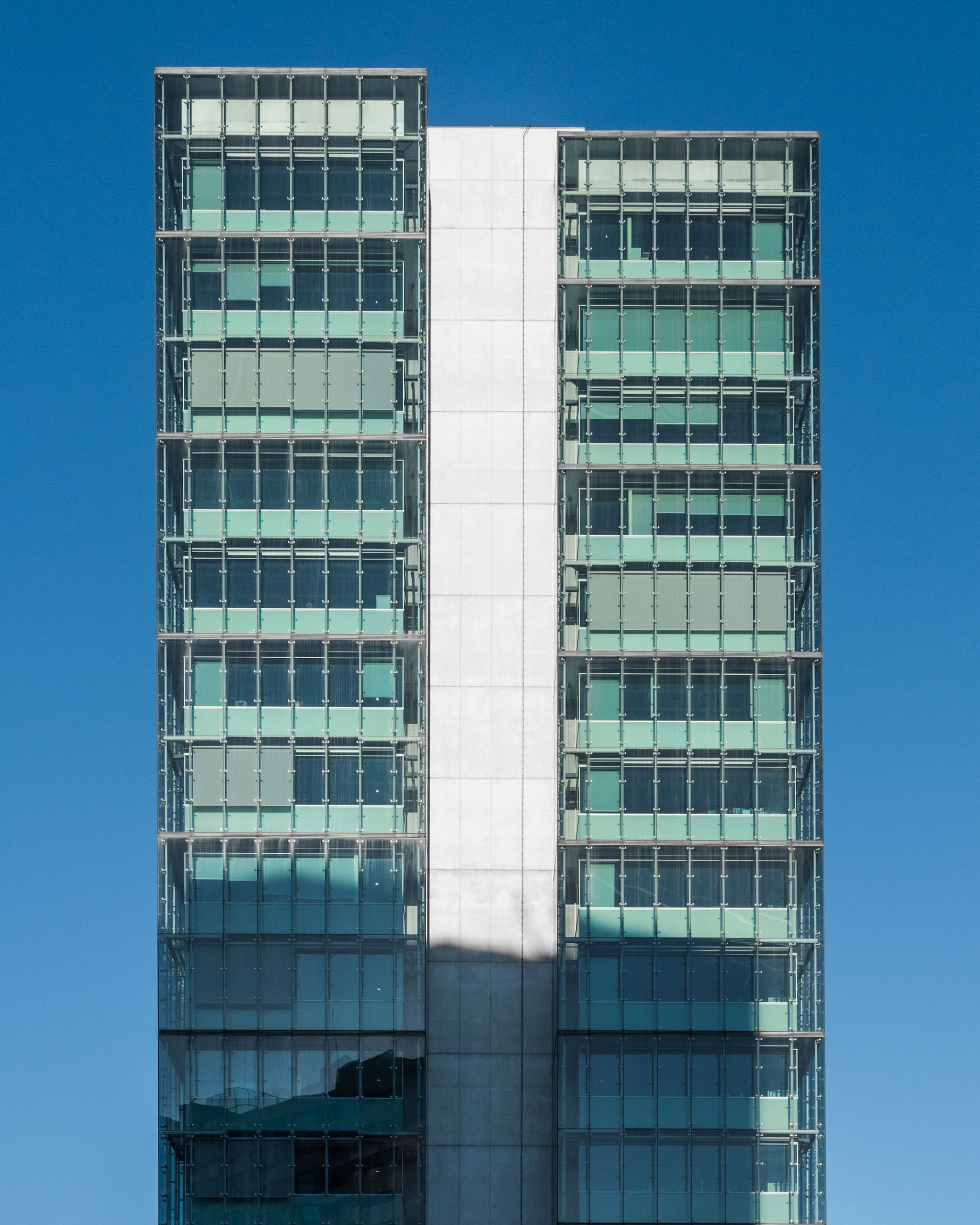 built structure, architecture, building exterior, building, office building exterior, modern, office, sky, low angle view, glass - material, no people, city, day, nature, outdoors, clear sky, reflection, blue, window, sunlight, skyscraper