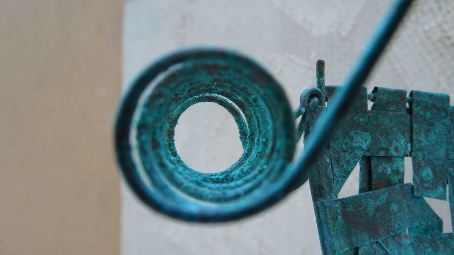 Close-up of weathered spiral copper