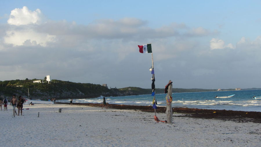 Beach Life Tulum , Rivera Maya. Beach Beauty In Nature Day Flag Horizon Over Water Nature One Person Outdoors People Real People Sand Scenics Sea Shore Sky Sport Water