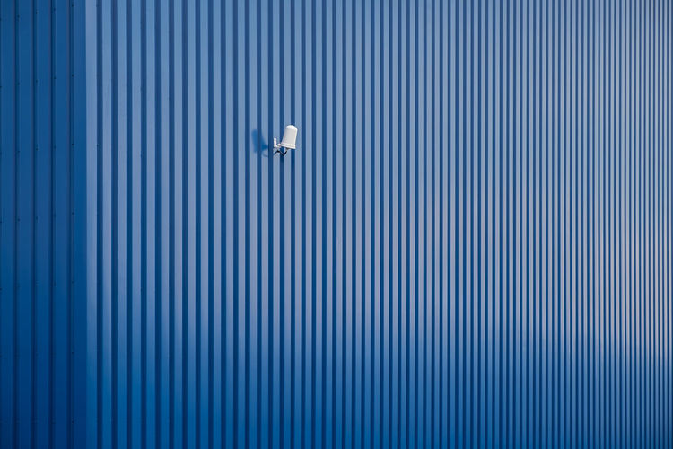 Lighting Equipment On Blue Striped Wall