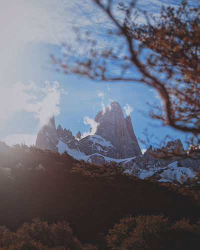 Sky Beauty In Nature Nature Plant Scenics - Nature Rock Mountain Tranquil Scene Tranquility Winter Tree Rock - Object Cold Temperature No People Day Sunlight Snow Cloud - Sky Solid Outdoors Mountain Peak Snowcapped Mountain
