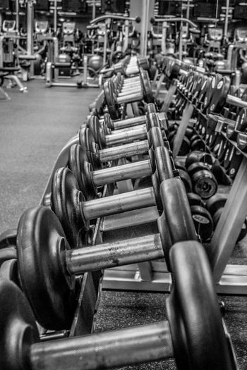 More pain, more... 18-105mm Black & White Black And White Dumbbell Dumbbells Excercise Excercising Gym Indoors  Large Group Of Objects Machines Mirror Mirror Reflection Pattern Reflection Series Sony A6000 Sport Weight Weightlifting Weights