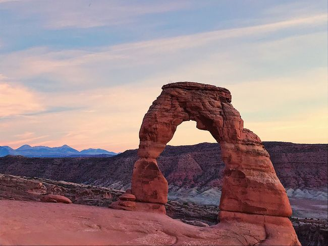 Rock Formation Rock - Object Nature Geology Sky Tranquility Beauty In Nature Scenics Tranquil Scene Cloud - Sky Travel Destinations Physical Geography Sunset No People Natural Arch Landscape Outdoors Desert Arid Climate Day Delicate Delicate Arch Hike Twilight Perspectives On Nature