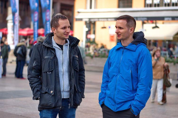 Men standing on street in city