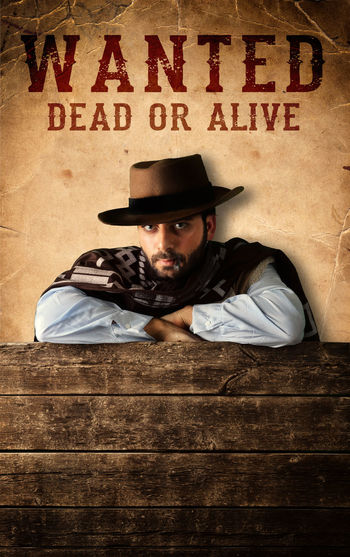 Wanted Bad Gunman in the old wild west Gunman Wanted Adult Beard Casual Clothing Day Gunfighter Gunslinger  Hat Old Wild West One Man Only One Person People Portrait Text Wantedposter Western Young Adult Young Men