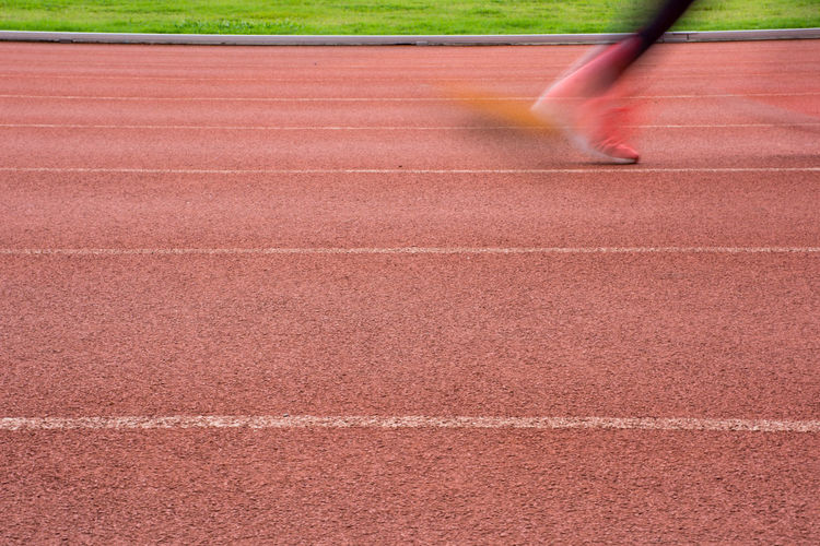 Blurred motion of person running on track