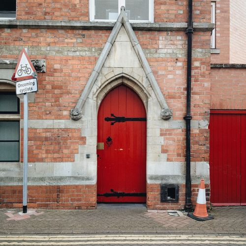 Arch Architecture Brick Wall Building Exterior Built Structure Door Façade Natural Light No People Outdoors Red Streetphotography