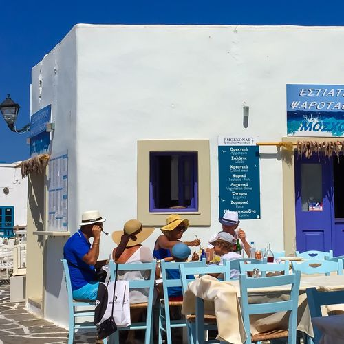 Greece Paros Family Lunch Eating Outside Fish Day Sunny Day Real People Outdoors Sky Table People Summer Summertime Summer Lunch  Big family having lunch in Paros (Greece) The Street Photographer - 2017 EyeEm Awards
