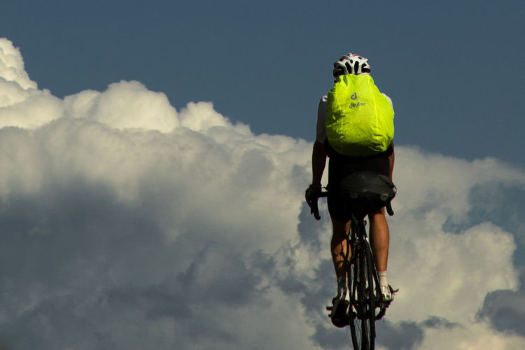 cycling into the sky Athlete Road Travel America Backpack Bicycle Cloud - Sky Clouds And Sky Cycling Day Low Angle View Nature Neon Outdoors Roadtrip Route Sky Trained Training Vacation