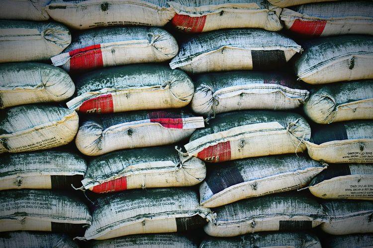 Full frame shot of sacks for sale at factory