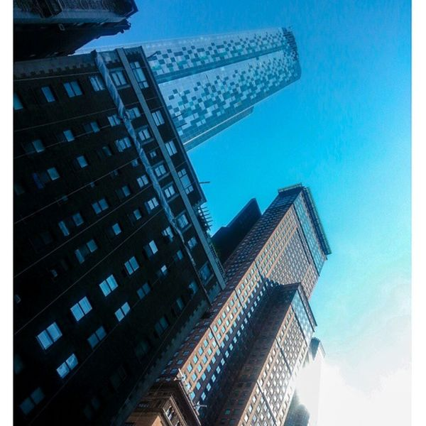 New York City Life. Look up! Blue skies abound as summer wanes. The view from below. Just below Central Park South. Midtown Manhattan NYC Buldings Sky Urban commerce manhattan newyorkcity