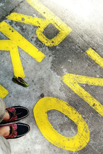 NO PARKING Streetphotography Close-up Shoeadventure Yellow Standing High Angle View Road Day Outdoors The Street Photographer - 2017 EyeEm Awards EyeEmNewHere