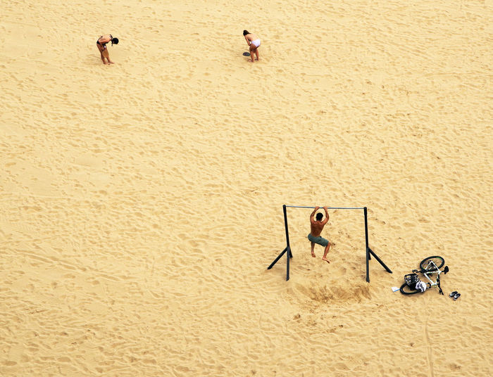 High Angle View Of Man Exercising On Beach