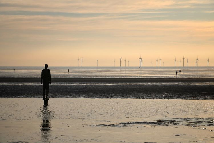 Crosby Beach Sky Scenics - Nature Water Beauty In Nature Sea Nature Crosby Beach Beach Sunset Land Real People Silhouette Men Cloud - Sky Standing Lifestyles One Person Rear View Leisure Activity Full Length Horizon Over Water Outdoors