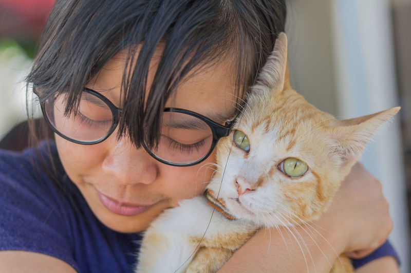Close-up of woman holding cat