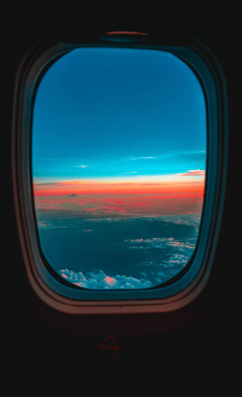 Air Vehicle Airplane Beauty In Nature Cloud - Sky Flying Glass - Material Indoors  Mode Of Transportation Nature No People Public Transportation Scenics - Nature Sky Sunset Transparent Transportation Travel Vehicle Interior Window Window View