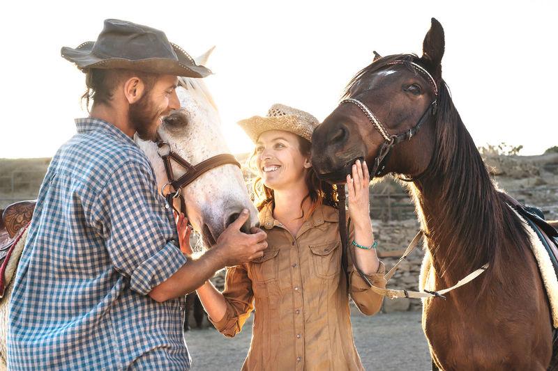 Friends standing in a horse