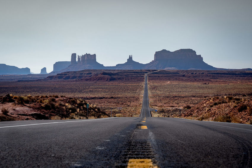 Road into Monument Valley Arizona Indian Land Monument Valley,Utah USA Beauty In Nature Clear Sky Day Destination Forest Gump Landscape Long Road Ahead Mountain Nature No People Outdoors Road Road To Somewhere Scenics Sky The Way Forward Tranquility Transportation