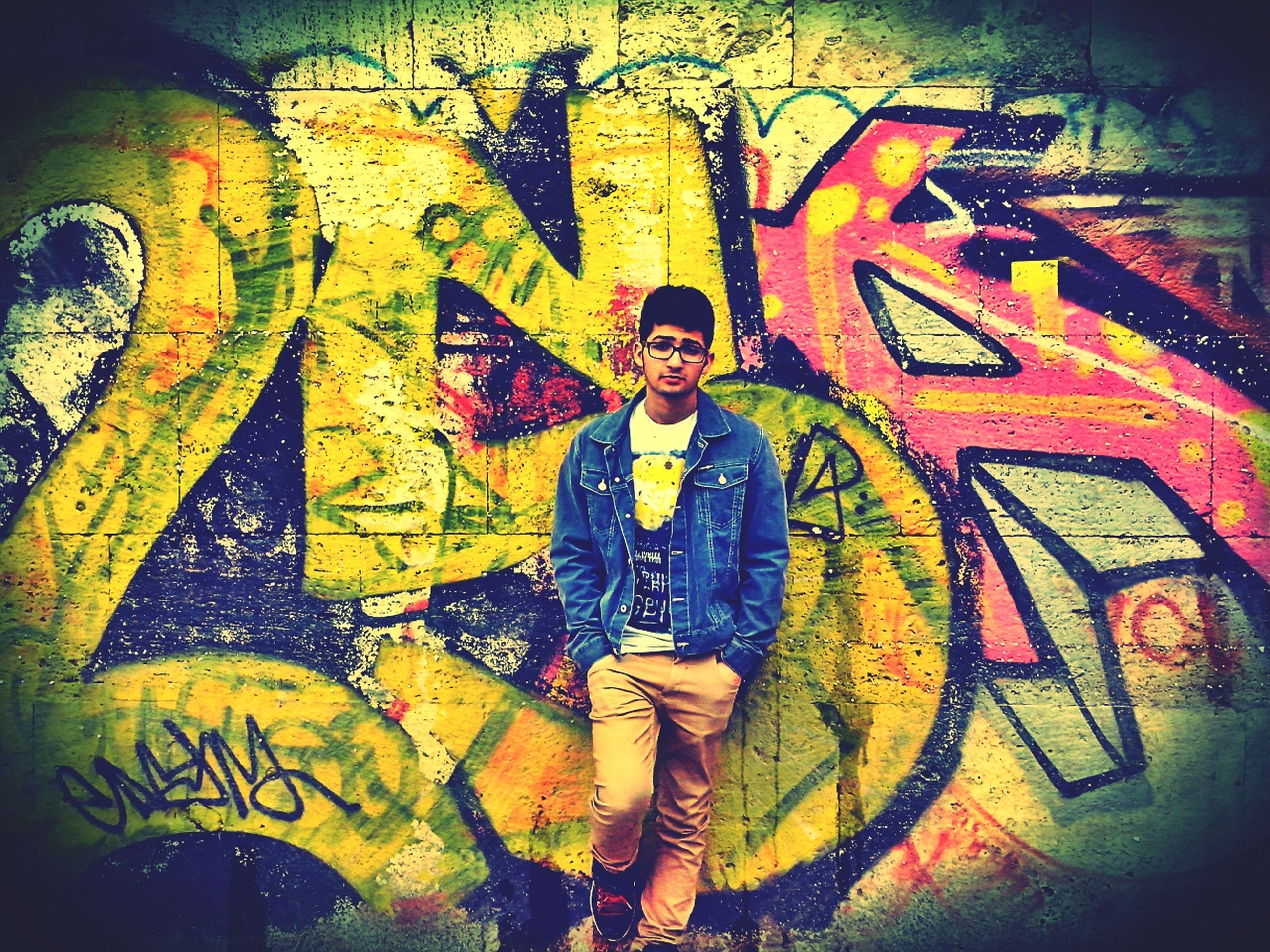 art, creativity, art and craft, graffiti, human representation, wall - building feature, street art, text, multi colored, yellow, wall, animal representation, orange color, craft, built structure, mural, outdoors
