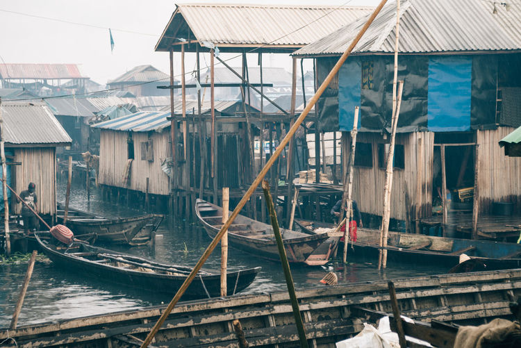 Makoko Slum Makoko Architecture Building Building Exterior Built Structure Canal Day House Mode Of Transportation Moored Nature Nautical Vessel No People Old Outdoors Residential District Roof Stilt House Transportation Water Wood - Material Wooden Post