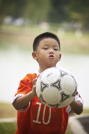 boy with soccer ball Field Football Fun Grass Happiness Active Activity Boy Cheerful Childhood Elementary Age Goal Lifestyles One Person Outdoors Park - Man Made Space Player Playing Real People Soccer Soccer Ball Soccer Player Sports Clothing Sports Uniform Waist Up