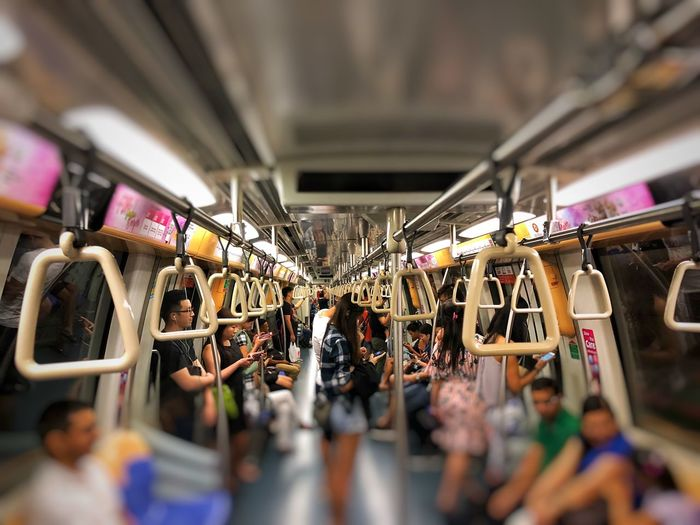 Subway Train Travel Train Subway Large Group Of People Indoors  Selective Focus Men Women Real People Illuminated