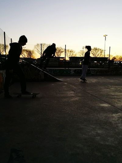 waiting game sunset in Florence, Silhouette Sunlight Outdoors People Sky Sunset City Urban Lifestyle Urban Landscape Urbanphotography Urban Exploration Sport Streetphotography Playground Structure Skateboard Park Skatepark Playground Rollercoaster Welcome To Black The Street Photographer - 2017 EyeEm Awards