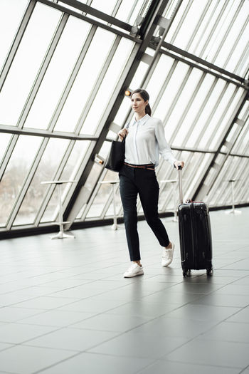 Full length of man walking at airport