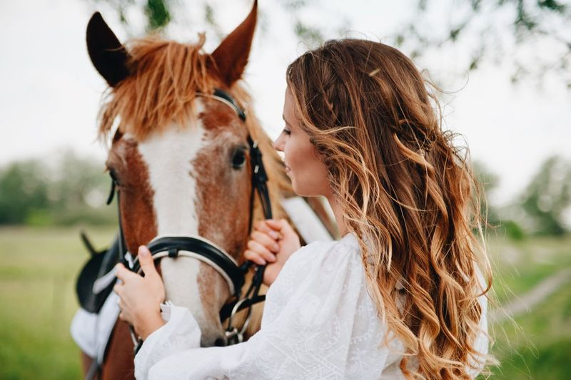 love story of young couple Adult Animal Wildlife Brown Hair Day Domestic Domestic Animals Females Focus On Foreground Hair Hairstyle Herbivorous Horse Livestock Long Hair Mammal Outdoors Pets Teenager Women Young Adult