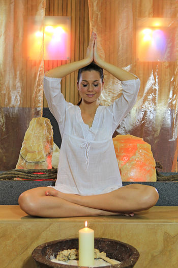 Young woman meditating in lotus position, yoga Beautiful Exercise Meditating Meditation Wellness Woman Yoga Yoga Pose Attractive Beautiful Woman Beauty Caucasian Fit Fitness Front View Leisure Activity Lifestyles One Person Pretty Relax Sitting Spa Spiritual Young Adult Zen