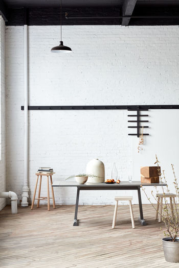Chairs and table against wall at home