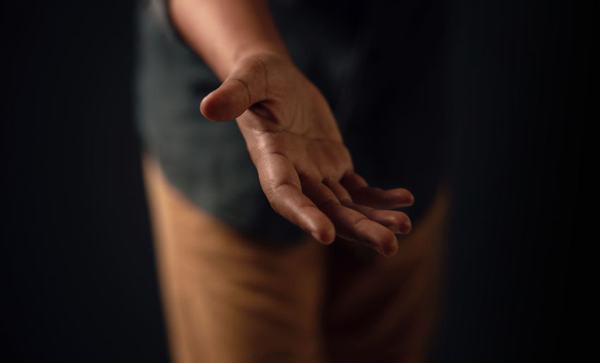 Midsection of man showing hand