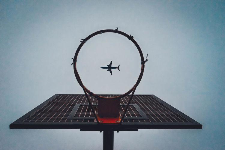 Basketball hoop against clear sky