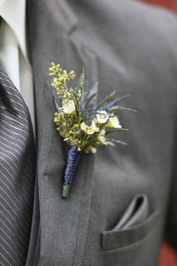 Midsection Of Bridegroom Wearing Flower Bouquet On Suit