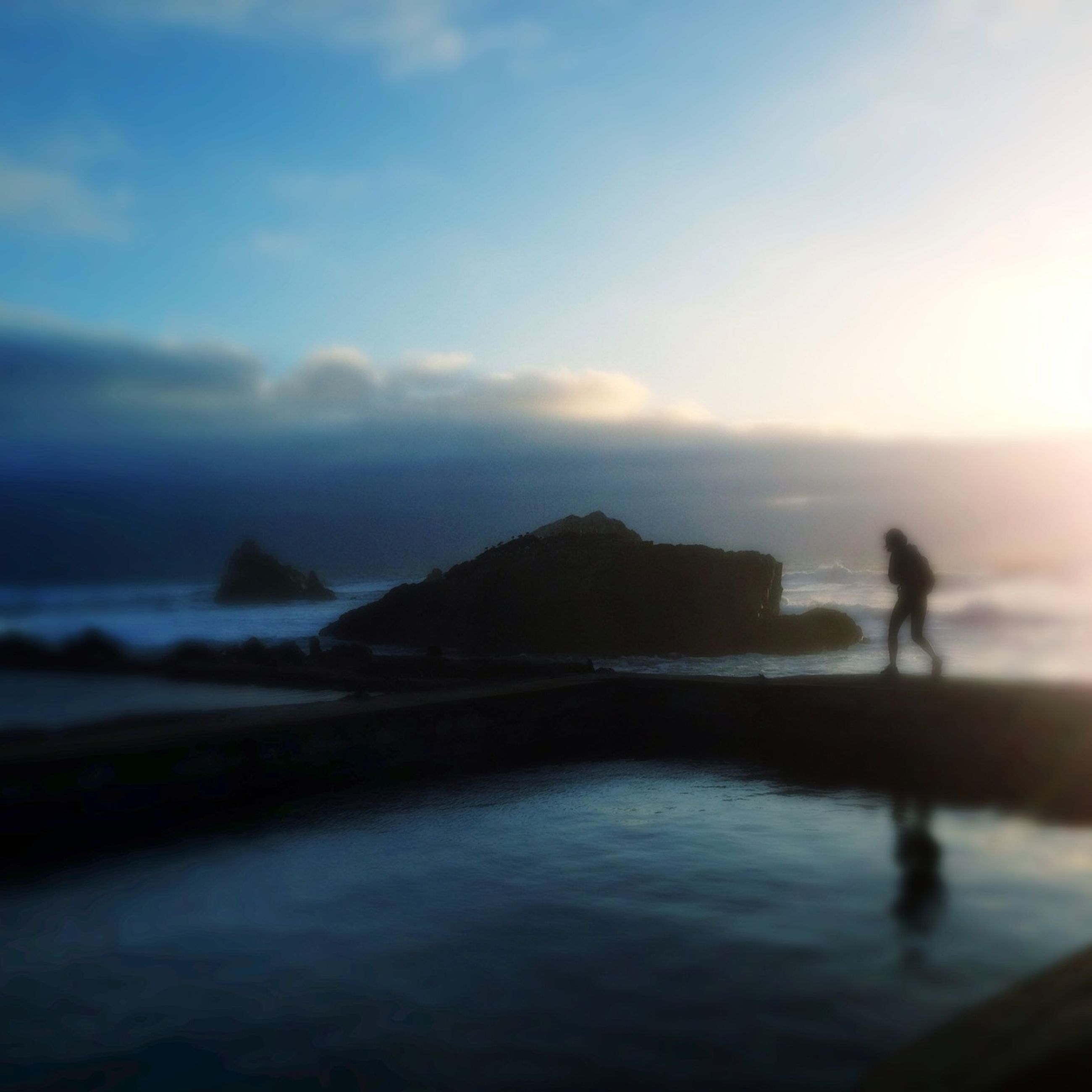 water, sea, silhouette, sky, tranquil scene, scenics, tranquility, beauty in nature, beach, lifestyles, leisure activity, nature, sunset, men, horizon over water, standing, cloud - sky, idyllic
