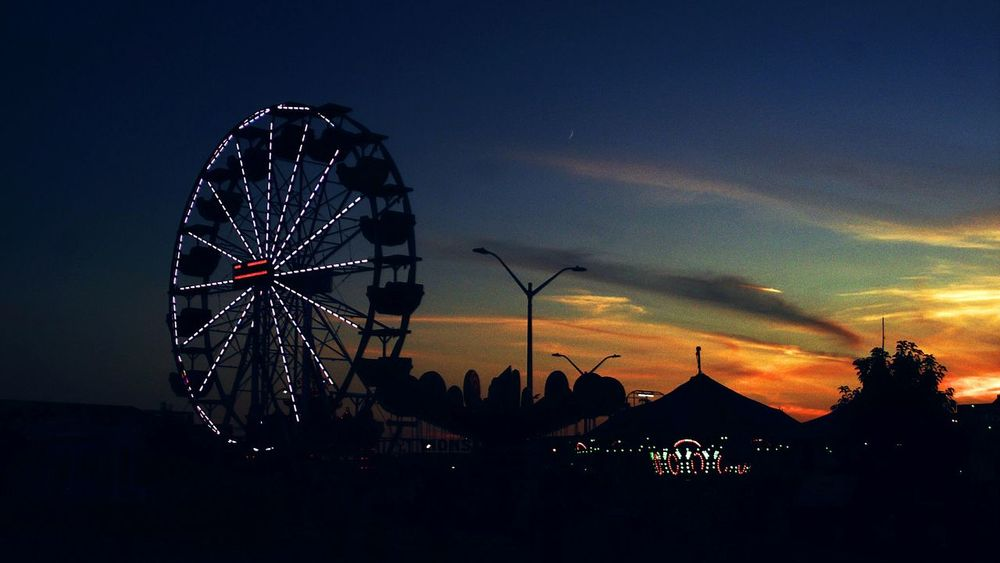 Human or Nature? Nature. Ferris Wheel Amusement Park Night Silhouette Travel Destinations Sky Arts Culture And Entertainment Sunset No People Outdoors Amusement Park Ride City Wasaga Beach Wasagabeach Canada Sunset_collection sun fun The Week On EyeEm 😚 😚 Sunset_captures Sunset_madness Sunsetting Blue Hour Fair Rides Fairground