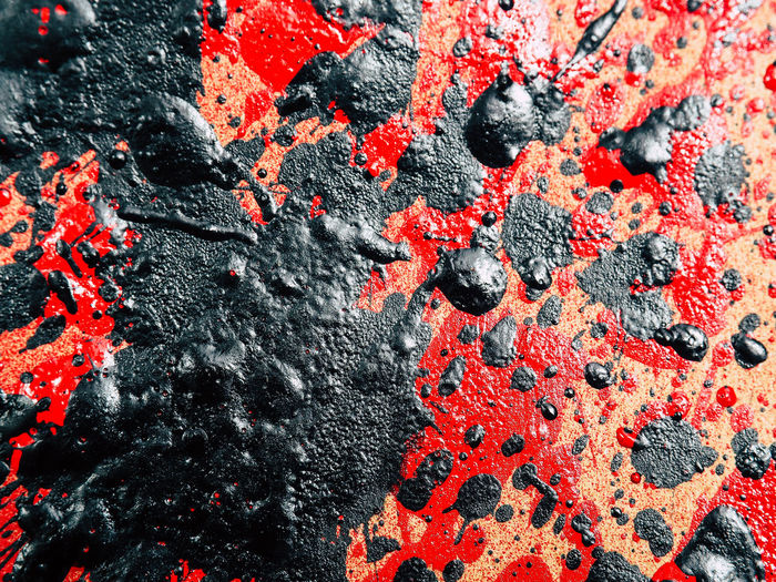 Close-up of black paint on damaged wall
