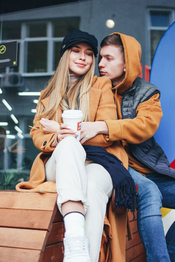Young couple sitting outdoors