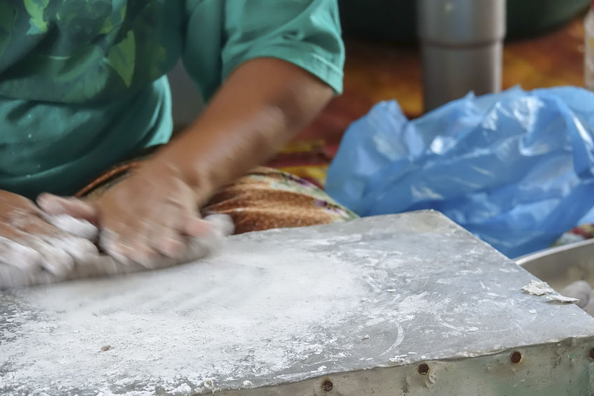 MAKING OF KEREPOK LEKOR MANUALLY Fish Sausage Small Business Working Hard Close-up Dough Flour Hand Human Body Part Human Hand Indoors  Lekor Making Making Lekor Midsection Occupation One Person Plastic Preparing Food Real People Selective Focus Table Traditional Unrecognizable Person White Color Working